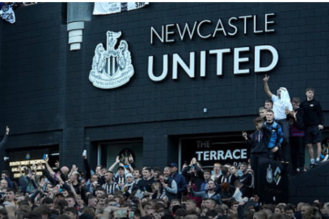Newcastle United fans celebrate in front of the stadium